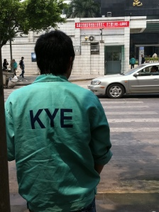 worker outside KYE factory
